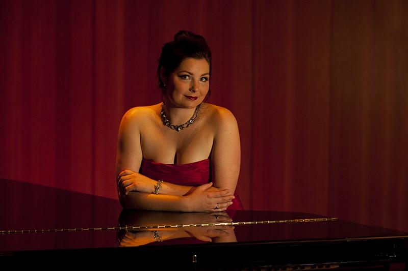 world class opera singer amy birch at a piano