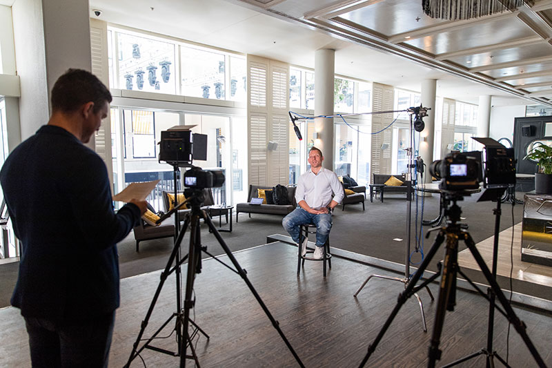behind the scenes filming a corporate video with sydney corporate photography and video