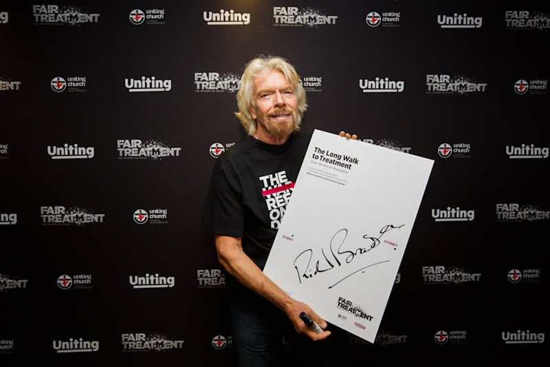 sir richard branson at a corporate event at the media wall