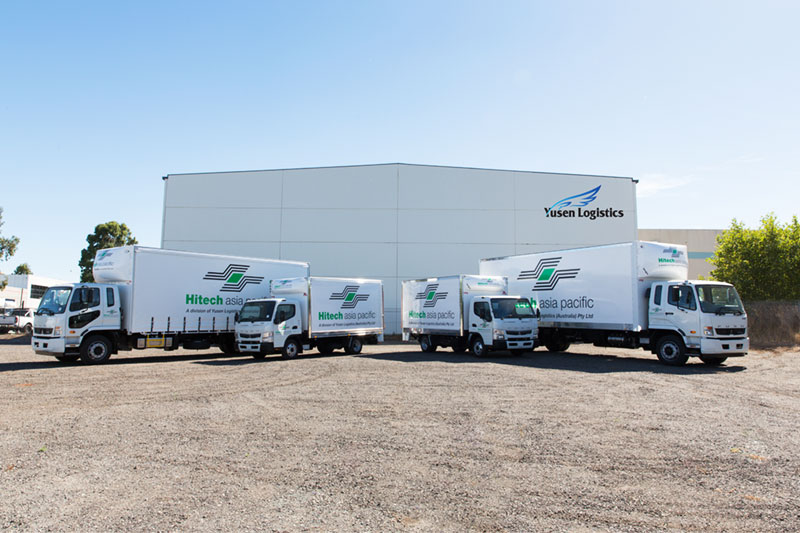 commercial product photograph of a fleet of trucks