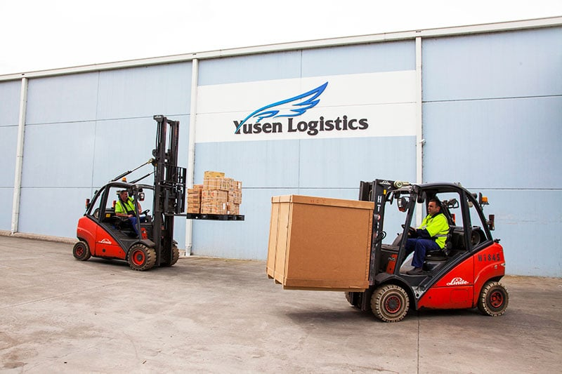 a pair of forklifts from the yusen logistics corporate storytelling image library