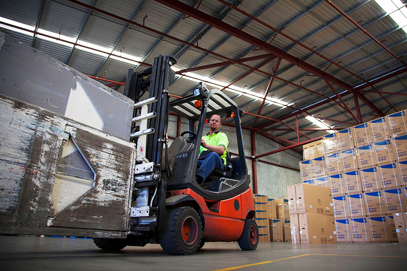 a man on a forklift from the yusen logistics corporate storytelling image library