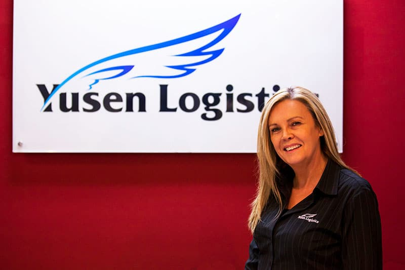 lady at the front desk yusen logistics corporate storytelling image library
