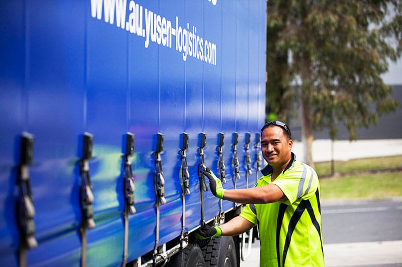 a man loading a truck from the yusen logistics corporate storytelling image library