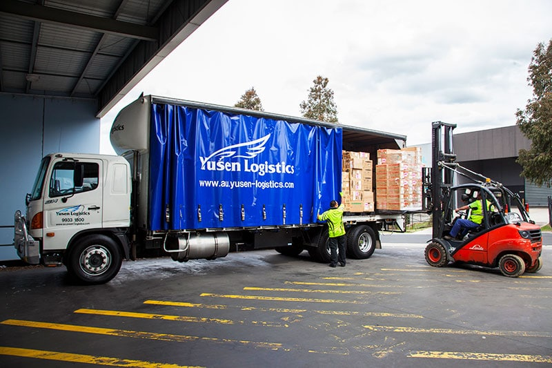 a truck being loaded from the yusen logistics corporate storytelling image library